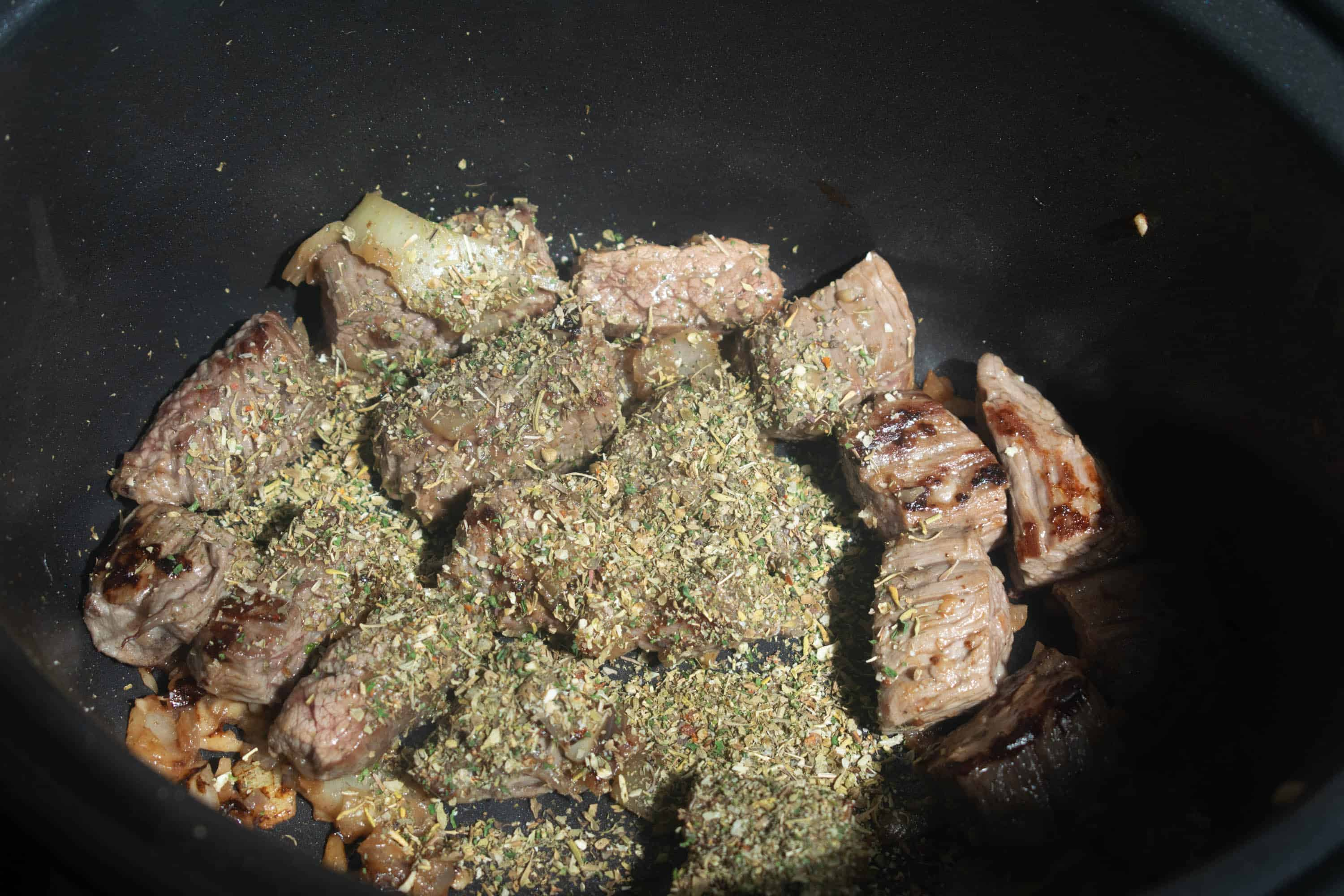 beef with seasoning in slow cooker