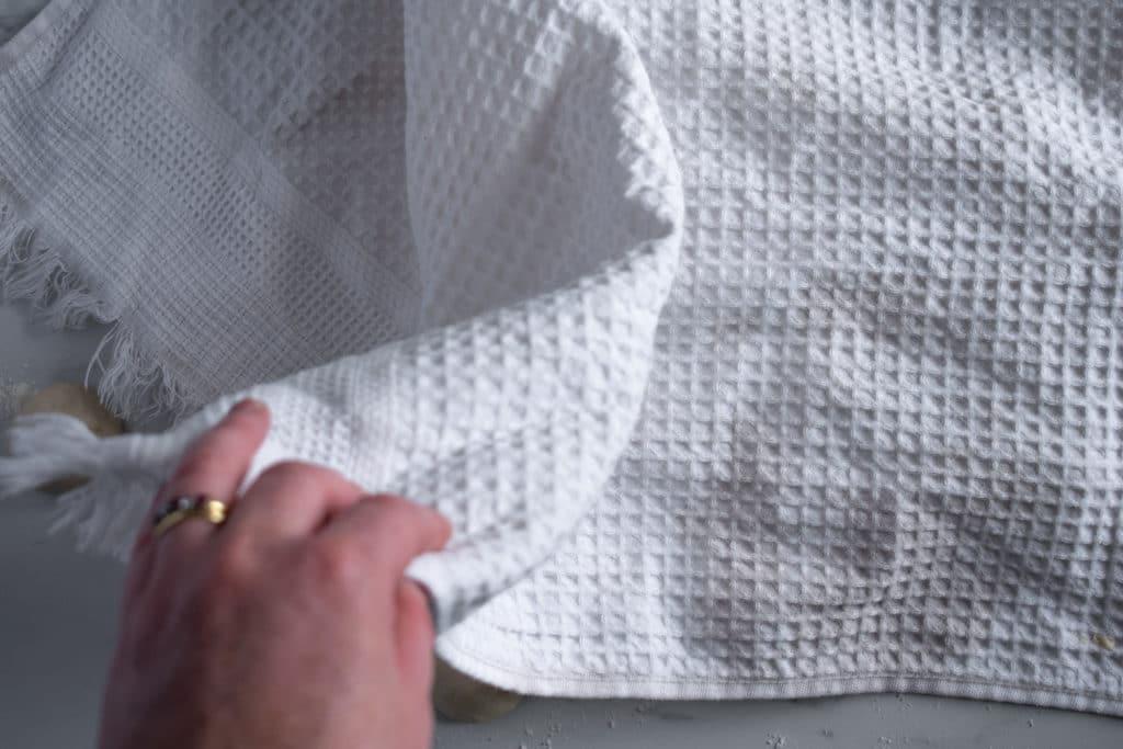 cover dough balls with tea towel